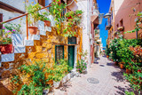 Fototapety Pictoresque mediterranean street with stairs and flower pots, Chania, island of Crete, Greece
