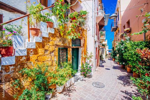 Zdjęcia na płótnie, fototapety na wymiar, obrazy na ścianę : Pictoresque mediterranean street with stairs and flower pots, Chania, island of Crete, Greece