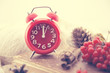 Winter Still life with red clock as a symbol of New Year, pine c