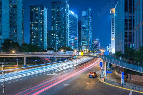 In de dag Tunnel night view of urban traffic with cityscape in Shanghai,China.