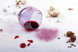 stains on tablecloth of spilled wine glass and food - 123440743