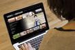 woman computer video on demand