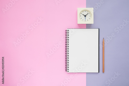 Top view of notebook pencil clock Poster