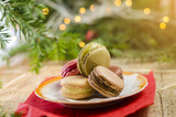 Christmas cookies, tasty macaroons on plate, bokeh lights in background