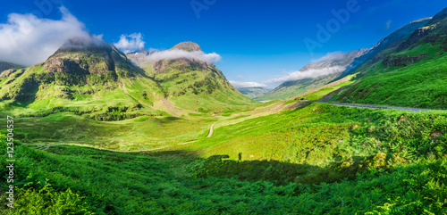 Stunning panorama in Glencoe at sunrise with shadow of man, Scotland Poster