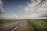asphalt road through the green field - 123517311
