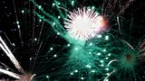Detail of fireworks,Large explosions in green and blue colors.slow motion