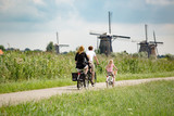 Family on bikes in nature - 123540353