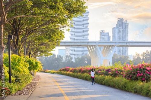 Jogger at Marina Bay East park at sunset Poster