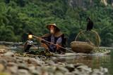 fisherman of Guilin, Li River and Karst mountains. Xingping, Yangshuo County, Guangxi Province, China.
