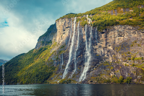 Mountain landscape with cloudy sky. Beautiful nature Norway.Geiranger fjord. Seven Sisters Waterfall - 123558592