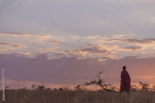 Foto op Plexiglas Zanzibar Maasai man walking on the savannah at sunset in Kenya