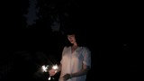 young woman playing with sparklers