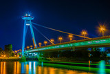 Night view of the illuminated SNP bridge over Danube in Bratislava