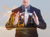 Double exposure of businessman in protecting global network coverage world map,Industrial Container Cargo freight ship for Logistic Import Export background (Elements of this image furnished by NASA)