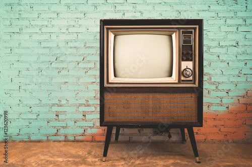Retro old television in vintage wall pastel color background Poster