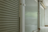 roller shutter door in warehouse building - 123634767
