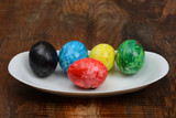 Set of Colorful Easter Eggs in Plate wood Background