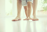 Parenting feet with baby walking first steps
