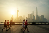 People running at Huangpu River riverside with Shanghai, China