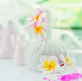 Spa setting with flowers at blurred nature background