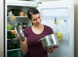 Girl near refrigerator at home