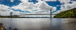 George Washington Bridge spans Hudson River and connects New York and New Jersey. Panoramic view with Manhattan skyline in the background