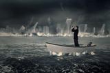 Male entrepreneur with binoculars in boat