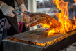 Grilling entrecote on a barbecue with fire
