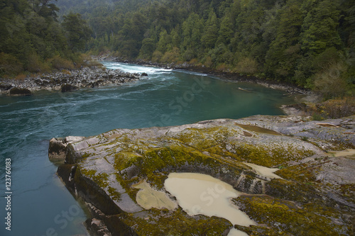 River Futaleufu flowing through mist shrouded forests in the Aysen Region of southern Chile Poster