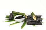 Bamboo charcoal burner and bamboo fresh in the basket and Bamboo charcoal powder. Woman.