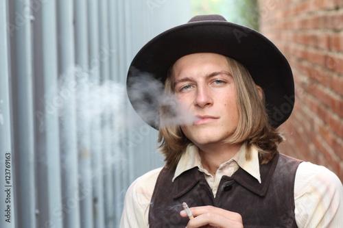 Poster Retro cowboy smoking cigarette. Young man