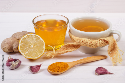 Poster Cup of tea with lemon and ingredients for preparation warming beverage