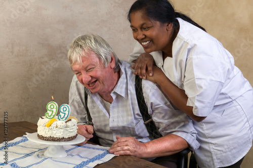 Happy pensioner with birthday cake Poster