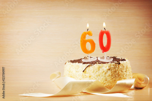 Birthday cake with burning candle as a number sixty Poster