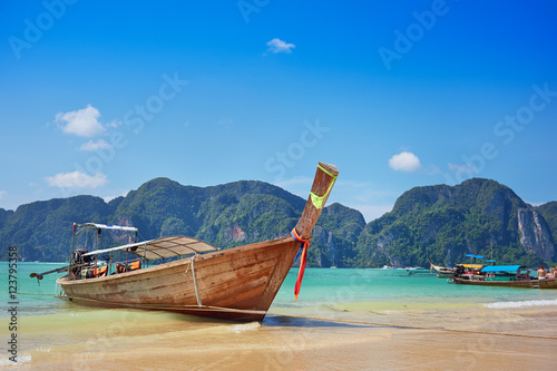 Poster Longtail boat in the beautiful sea over clear sky