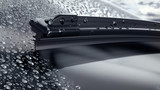 Fototapety Car windshield with rain drops and frameless wiper blade closeup. 3d render