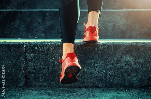 Foto Murales Close up shot of runner's shoes