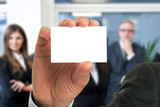 Businessman showing an empty business card