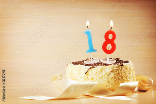 Birthday cake with burning candle as a number eighteen Poster