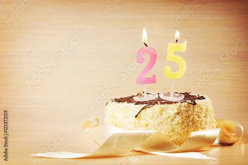 Poster Birthday cake with burning candle as a number twenty five