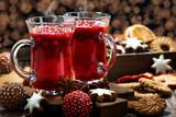 Christmas hot cranberry tea, cookies and light bokeh
