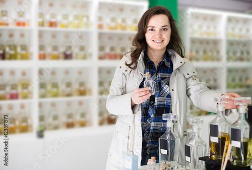 Poster Portrait of  brunette shopping in perfume store