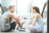 Young good looking couple relaxing together after urban workout.