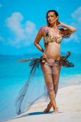 Portrait of exotic fantasy mermaid on the beach