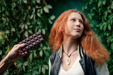 Portrait of young girl with red hair, refuse from chocolate bar