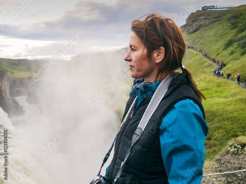Woman is standing at a Gullfoss waterfall - Iceland Poster