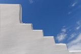 whitewashed staircase on Santorini over blue sky