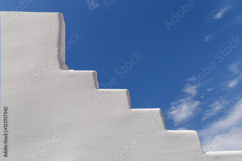 Fotobehang Santorini whitewashed staircase on Santorini over blue sky