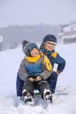 happy boys on sled
